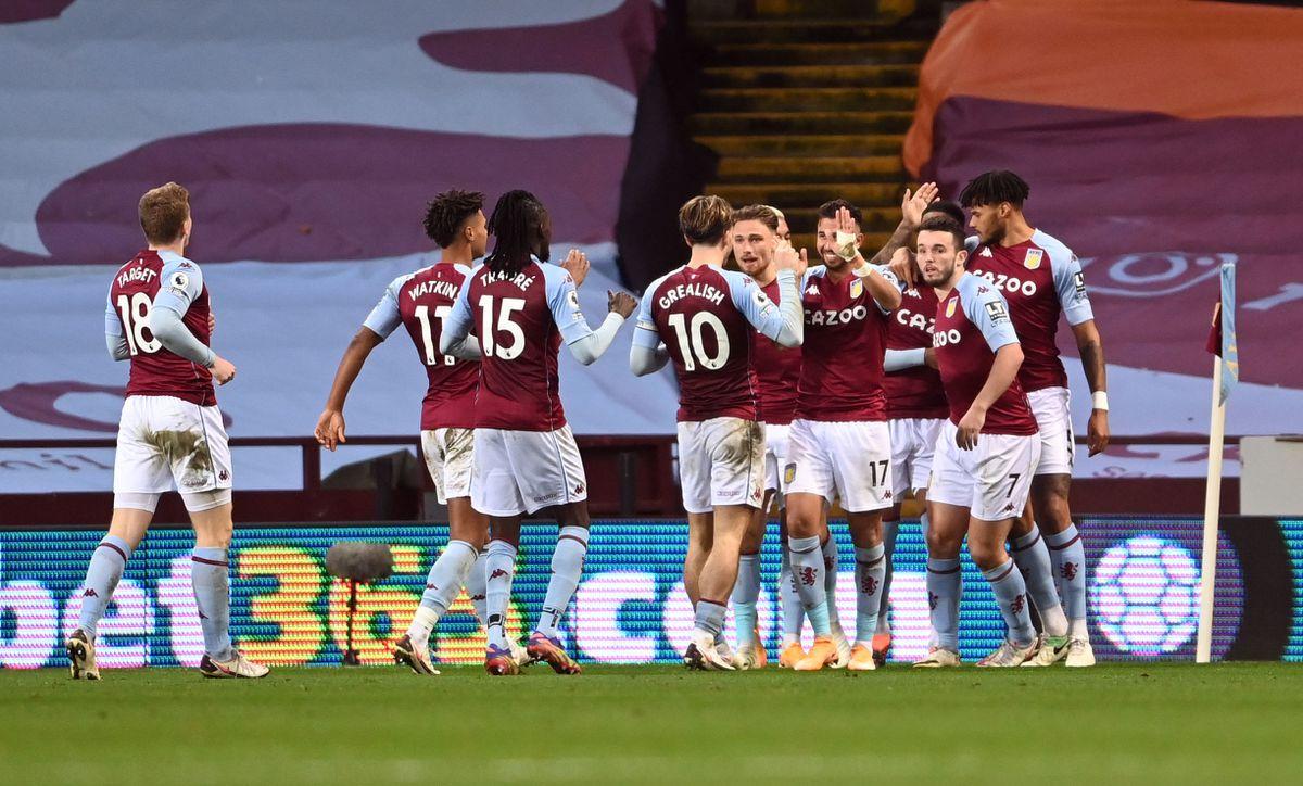 Aston Villa players celebrate the equalising goal scored by Ezri Konsa to make it 1-1