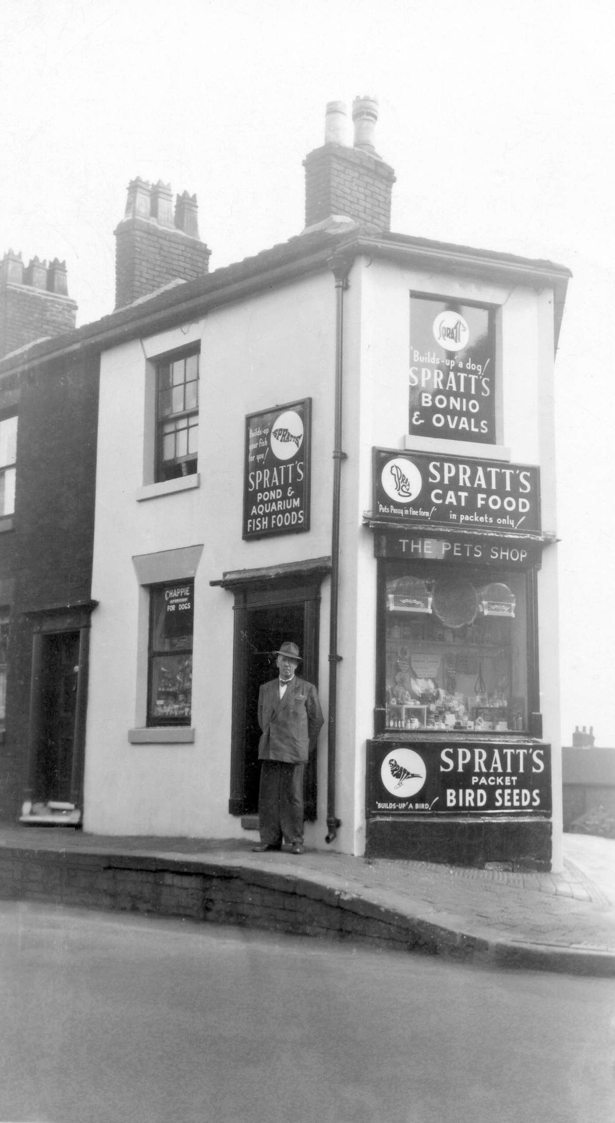 All my own work... Andy's grandfather Charles Harrington outside Spratts pet shop, location unknown.