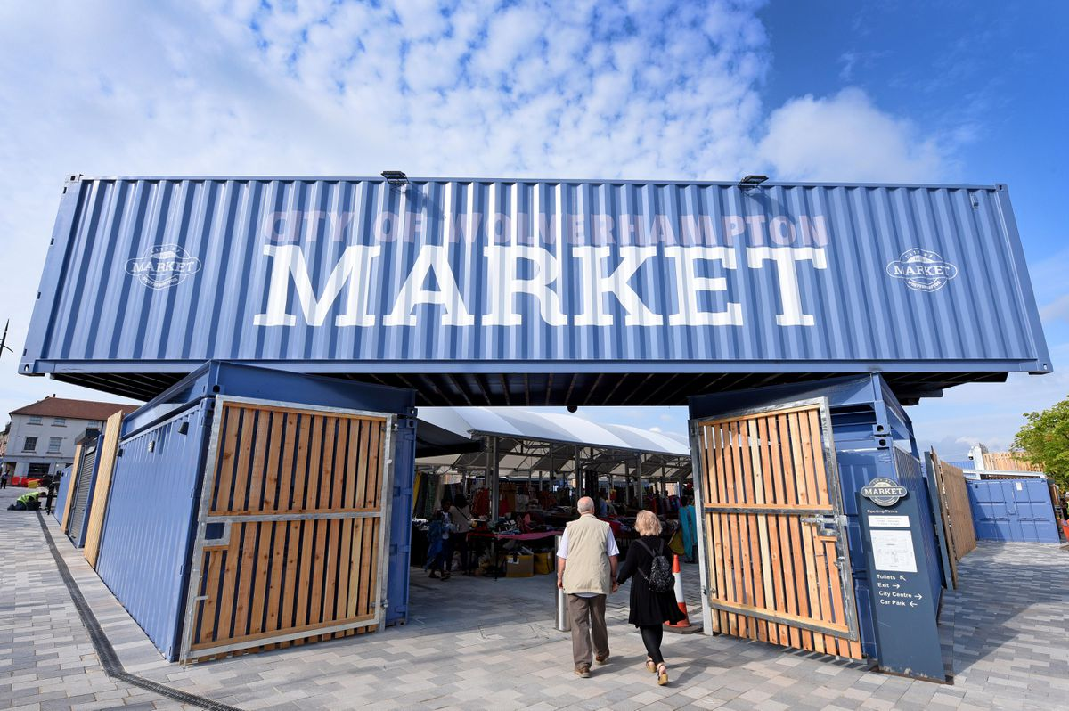 The entrance to the market is made out of three shipping containers