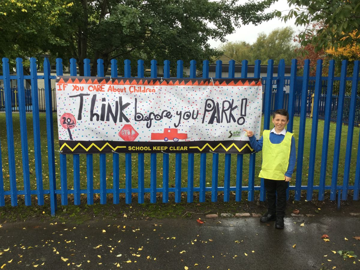 """Cameron, also aged 10 with his poster - """"If you care about children, think before you park."""""""