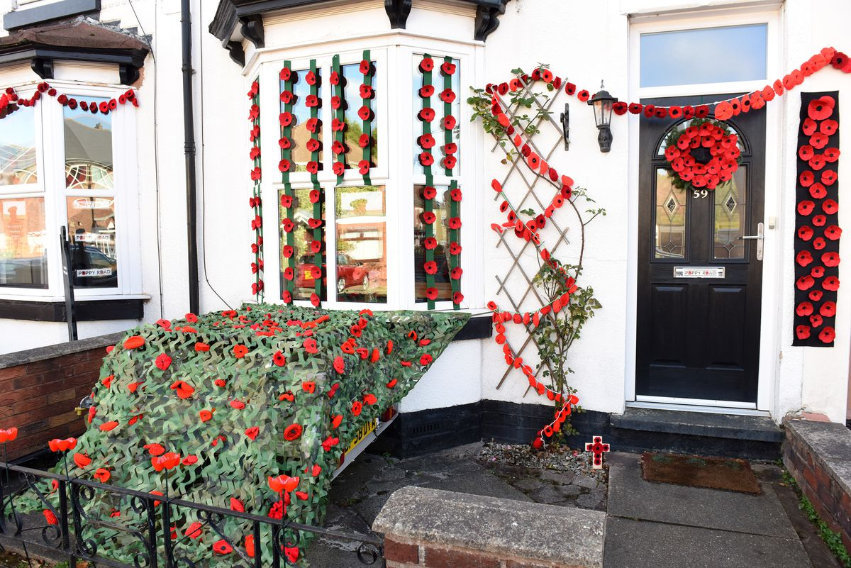 Another of the homes dressed with poppies