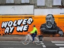 Stunning Wolves graffiti brightens up abandoned city shop