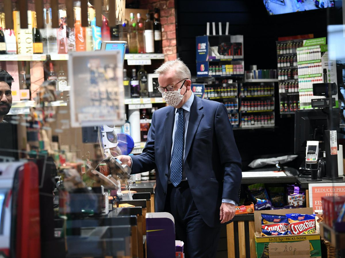 Cabinet Office Minister Michael Gove wearing a face mask in a shop