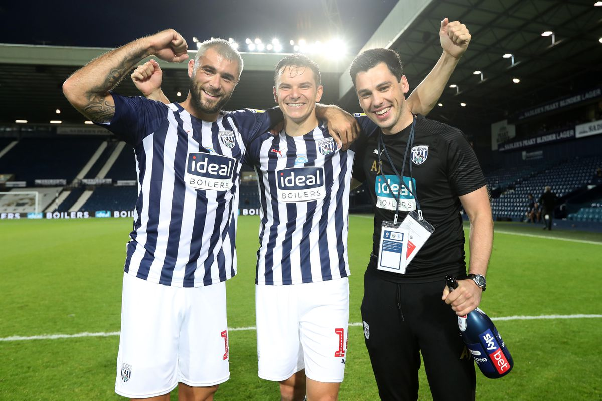 Charlie Austin of West Bromwich Albion and Conor Townsend of West Bromwich Albion celebrate promotion to the Premier League on the pitch at the end of the match. (AMA)