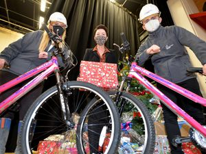 WOLVERHAMPTON  COPYRIGHT TIM STURGESS EXPRESS AND STAR...... 16/12/2020. St Modwen Homes donated £500 to Moreton School so they could buy bicycles for two  deserving students. Pictured left ,  Gemma Batchelor, head Nicola Bayliss and Dylan Stephenson..