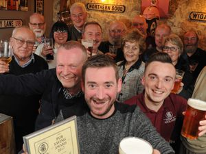 Celebrating a bronze award from CAMRA, (centre) manager Matt Carey, of Cradley Heath, with Friends of Haden Cross, including (front left) chairman Tim Haskey, of Cradley Heath, and members of Dudley & South Staffordshire CAMRA, including (front right) chairman Ryan Hunt, of Dudley, at The Haden Cross, Halesowen Road, Cradley Heath.