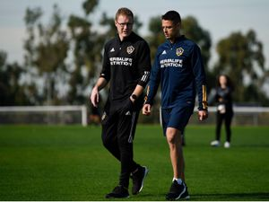 """Mandatory Credit: Photo by Kelvin Kuo/AP/Shutterstock (10537513n)..Javier Hern'ndez, Phil Hayward. Los Angeles Galaxy's Javier """"Chicharito"""" Hernández, right, walks off the field with the head of sports science Phil Hayward in Carson, Calif..MLS Galaxy Hernandez Soccer, Carson, USA - 23 Jan 2020."""