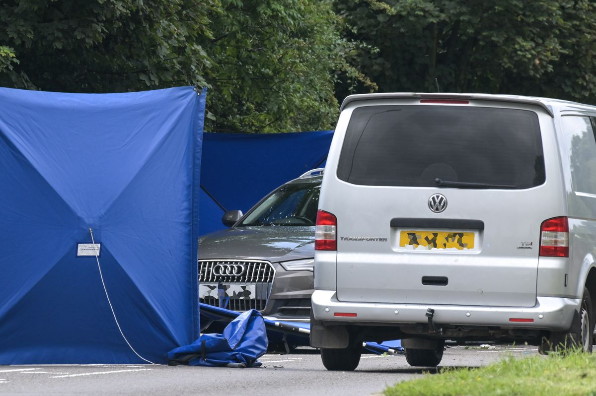 An unmarked police car was behind the cordon as investigators examined the scene. Photo: SnapperSK