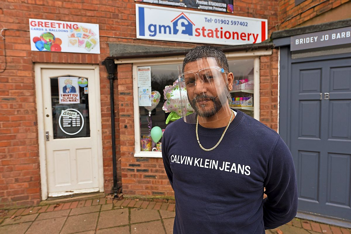 Waiting – Manni Massey outside his GM Stationery shop in Wombourne