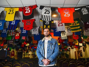 Jordan Sinnott's brother Tom looks at the vast collection of 826 football shirts with Sinnott printed on the back at Bradford City's Valley Parade football ground in Bradford, West Yorkshire.