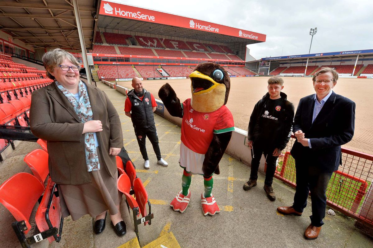 MS Coffey with Walsall FC's Adam Davey, mascot Swifty, Kickstart employee Jake Lloyd and Andy Snell from the EFL trust..