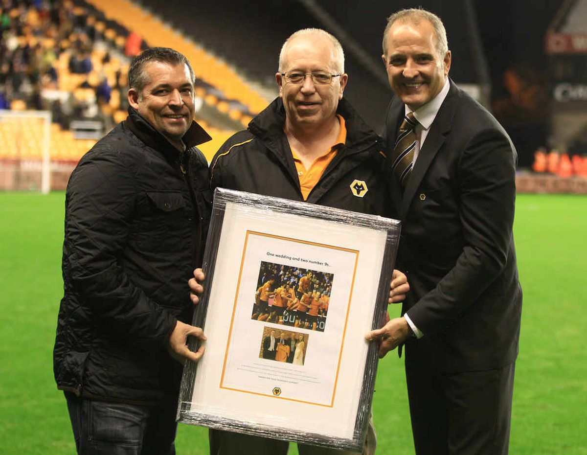 Andy Thompson and Steve Bull presented Peter Abbott with a framed picture after he missed his first home game for 37 years in 2013