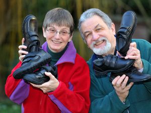 Maggie and Alan Marriott with shoes that are set to go out to asylum seeker families in Wolverhampton