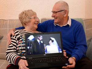 Margaret and Brian Hill with footage of their wedding day they have seen for the first time