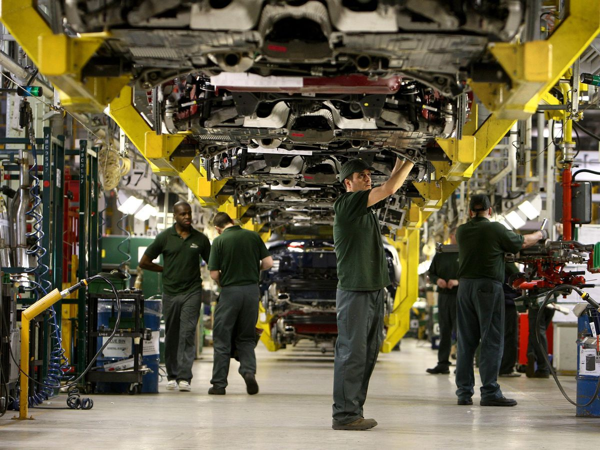 Workers on the production line at Jaguar Land Rover's Castle Bromwich branch