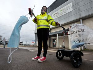Serco employee Lucy Wood with a mask and litter picker