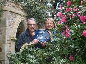 Anne and Brian Bailey in their garden in Compton