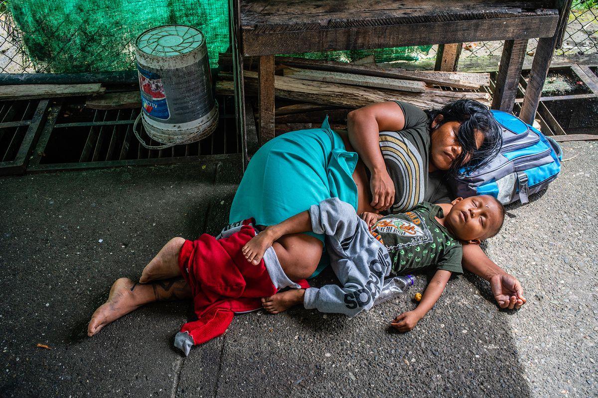 A mother and son sleep