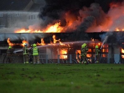 Dozens of firefighters tackling 'large and complex' blaze at high school