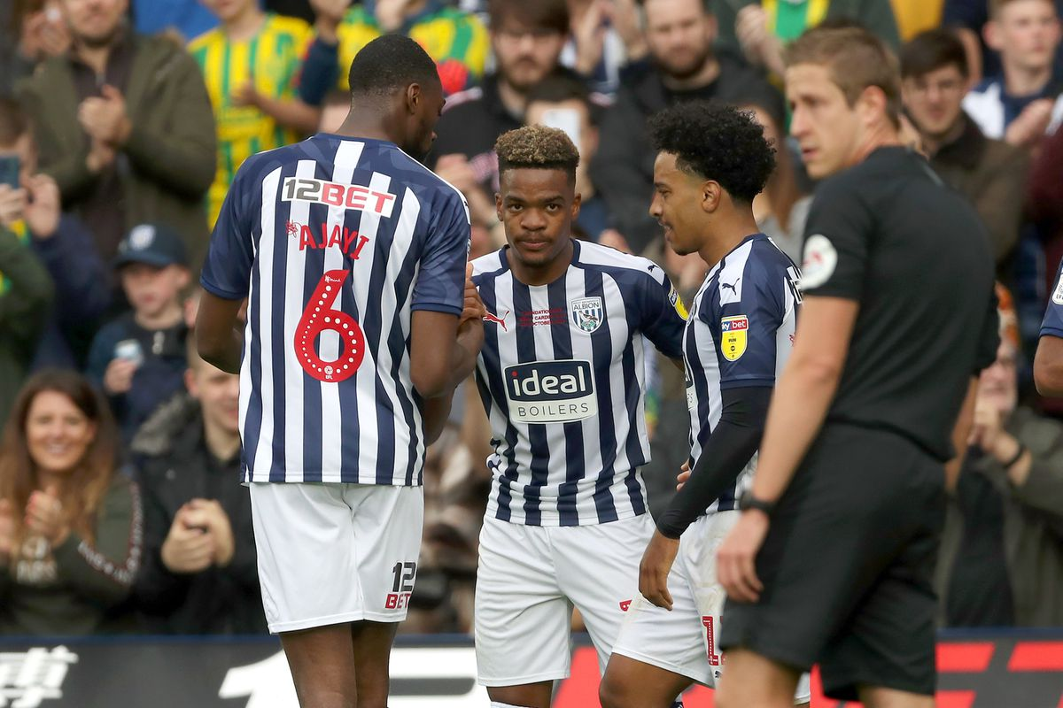 Grady Diangana of West Bromwich Albion celebrates after scoring a goal to make it 2-0 with Semi Ajayi of West Bromwich Albion and Matheus Pereira of West Bromwich Albion.