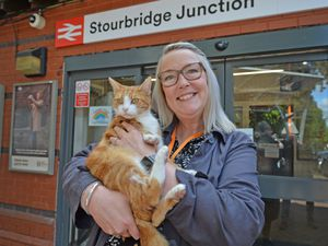 Simone Carter at Stourbridge Junction station with George the cat