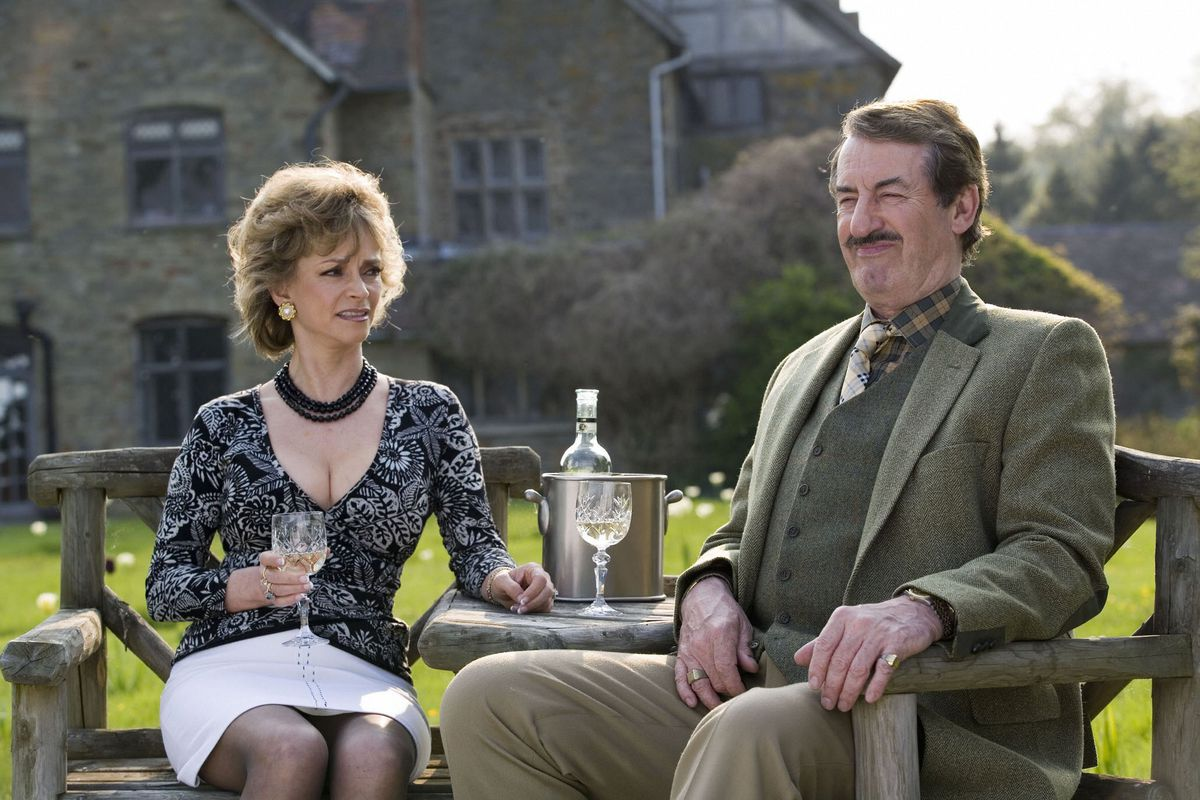 A country squire . . . John Challis with Sue Holderness in Boycie's spin-off series, The Green Green Grass