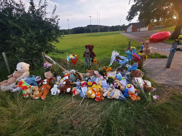 Tributes left near Pandy Park in Sarn, Bridgend, close to where the body of Logan Mwangi was discovered
