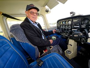 LAST COPYRIGHT EXPRESS&STAR TIM THURSFIELD-18/09/20.Retired aircraft engineer and racing driver Alan Cottam from Claverley enjoys a morning at Halpenny Green Airport, organised by his son Edward, to mark his 86th birthday.Alan ready for his surprise flight..