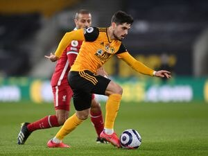 """Wolverhampton Wanderers' Pedro Neto in action during the Premier League match at Molineux Stadium, Wolverhampton. Picture date: Monday March 15, 2021. PA Photo. See PA story SOCCER Wolves. Photo credit should read: Laurence Griffiths/PA Wire.   RESTRICTIONS: EDITORIAL USE ONLY No use with  unauthorised audio, video, data, fixture lists, club/league logos or """"live"""" services. Online in-match use limited to 120 images, no video emulation. No use in betting, games or single club/league/player publications."""