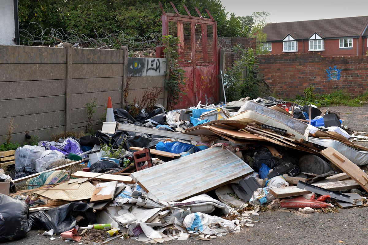 Some of the rubbish which has been left on the former Gould's TV store site on Bilston Street, Sedgley