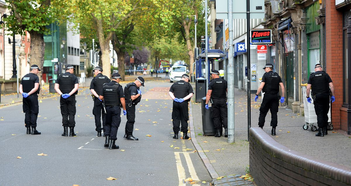 Officers searching nearby roads for evidence after the attack