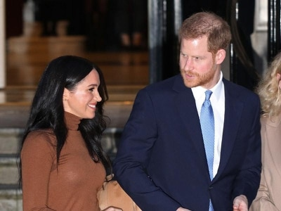 How did the North American press cover Harry and Meghan's decision to step away?