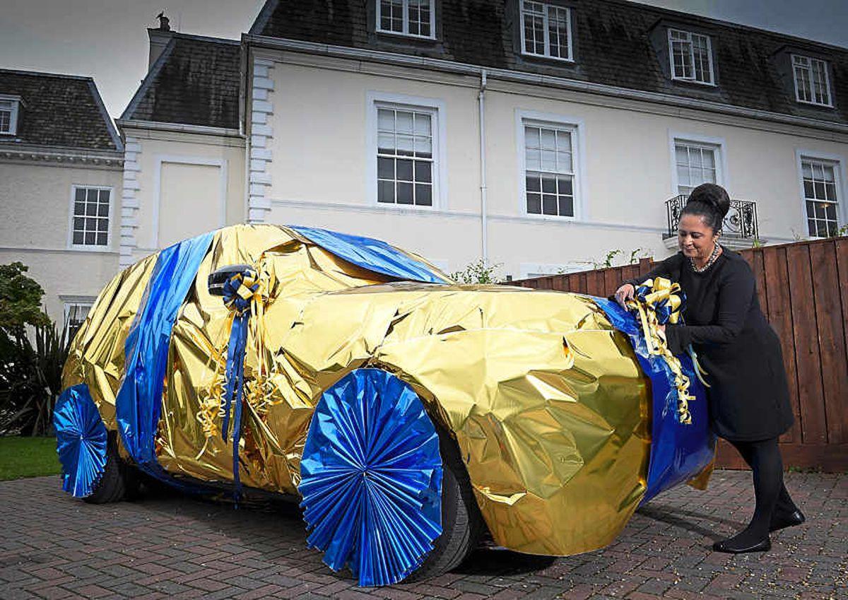 Neelam Meecha wraps a car at the EuroMillions Millionaire Academy