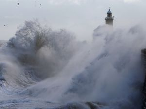 Waves crash against the pier wall at Tynemouth on the North East coast of England