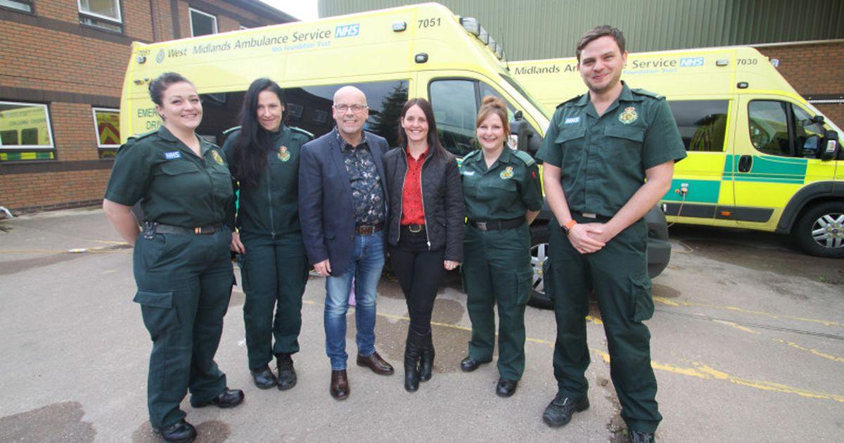Paramedics Anna Borecka, Michelle Adams, Lorraine McHugh and John Fryer, with Mark and Jenny Roberts, centre