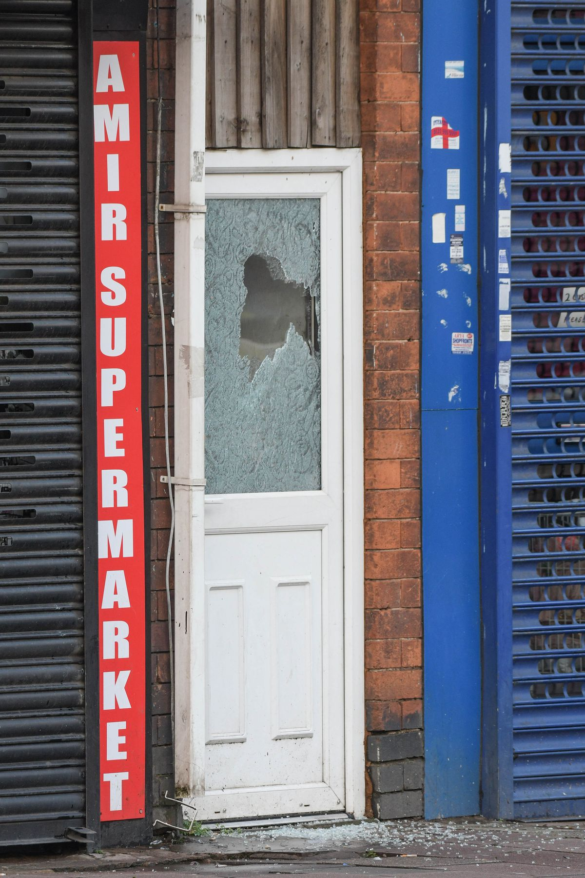 A shattered glass panel in a door. Photo: SnapperSK.