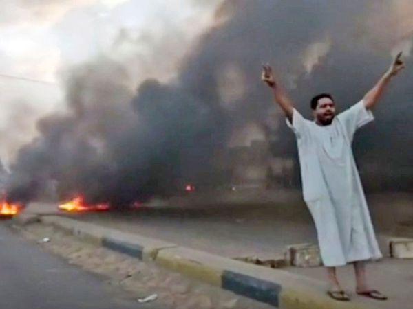 A man shouts slogans during a protest in Khartoum, Sudan