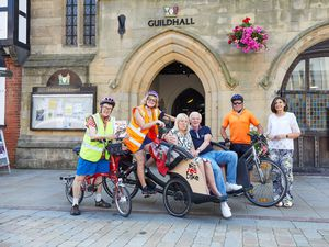 Lichfield Memory Cafe members getting ready for a tour of Lichfield on The Big Red Bike this summer.(Picture by Robert Yardley)