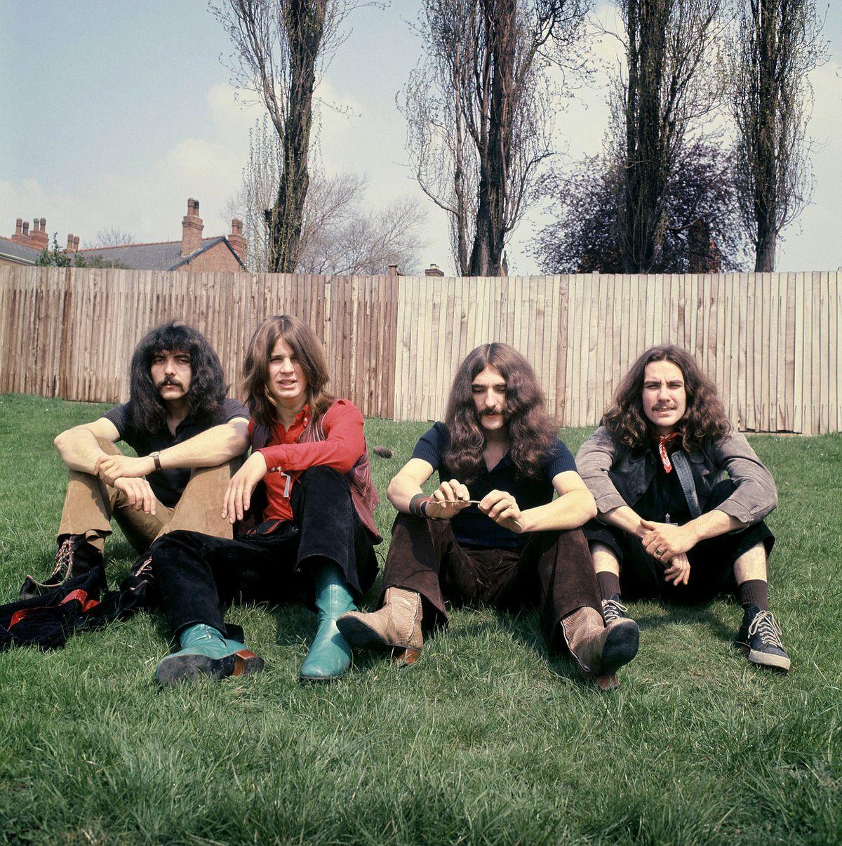 Black Sabbath during their early years outside Jim Simpson's home in Edgbaston Photo: Jim Simpson