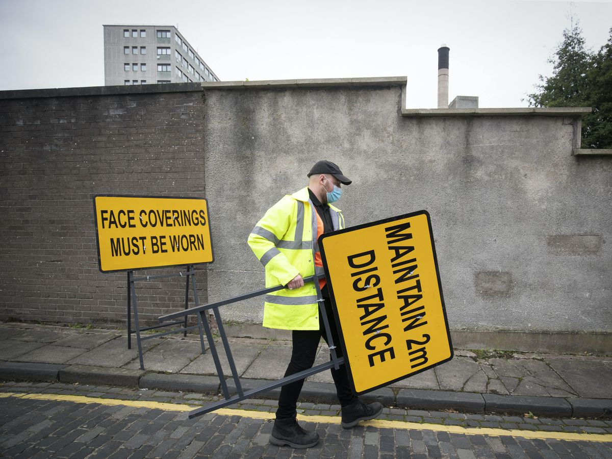 Signs are put in place at a walk-through Covid testing centre in Dundee