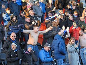 Halesowen Town fans are all smiles as their team shocked National League Barnet 2-1 to reach the FA Trophy semi-finals     Pic: Steve Evans
