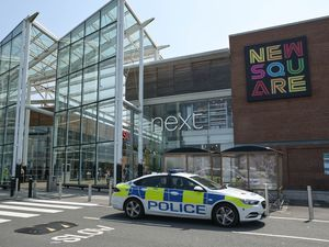 Police outside New Square Shopping Centre after two officers were attacked. Photo: SnapperSK