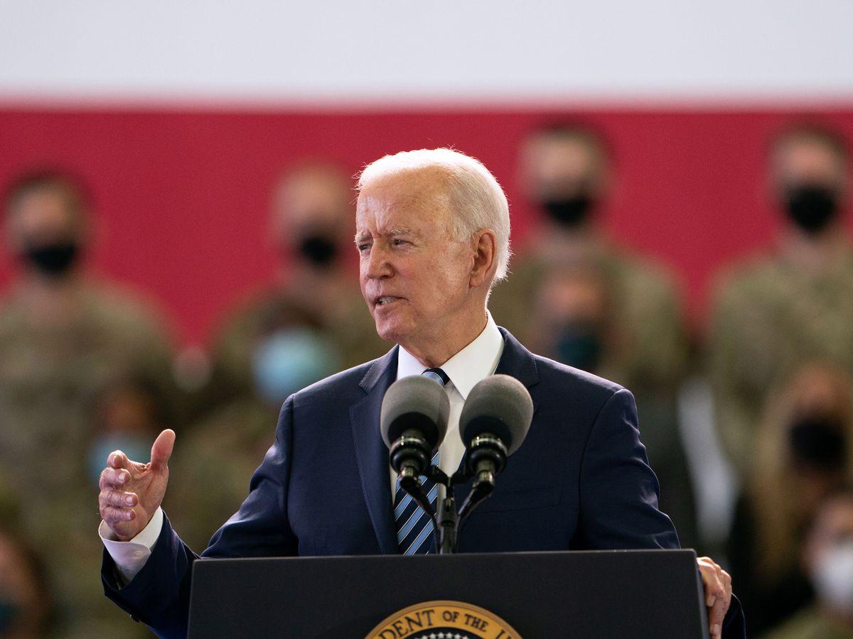 US President Joe Biden addresses US military personnel at RAF Mildenhall in Suffolk