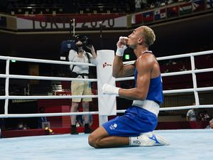 Ben Whittaker celebrates after winning against Russian Olympic Committee's Imam Khataev