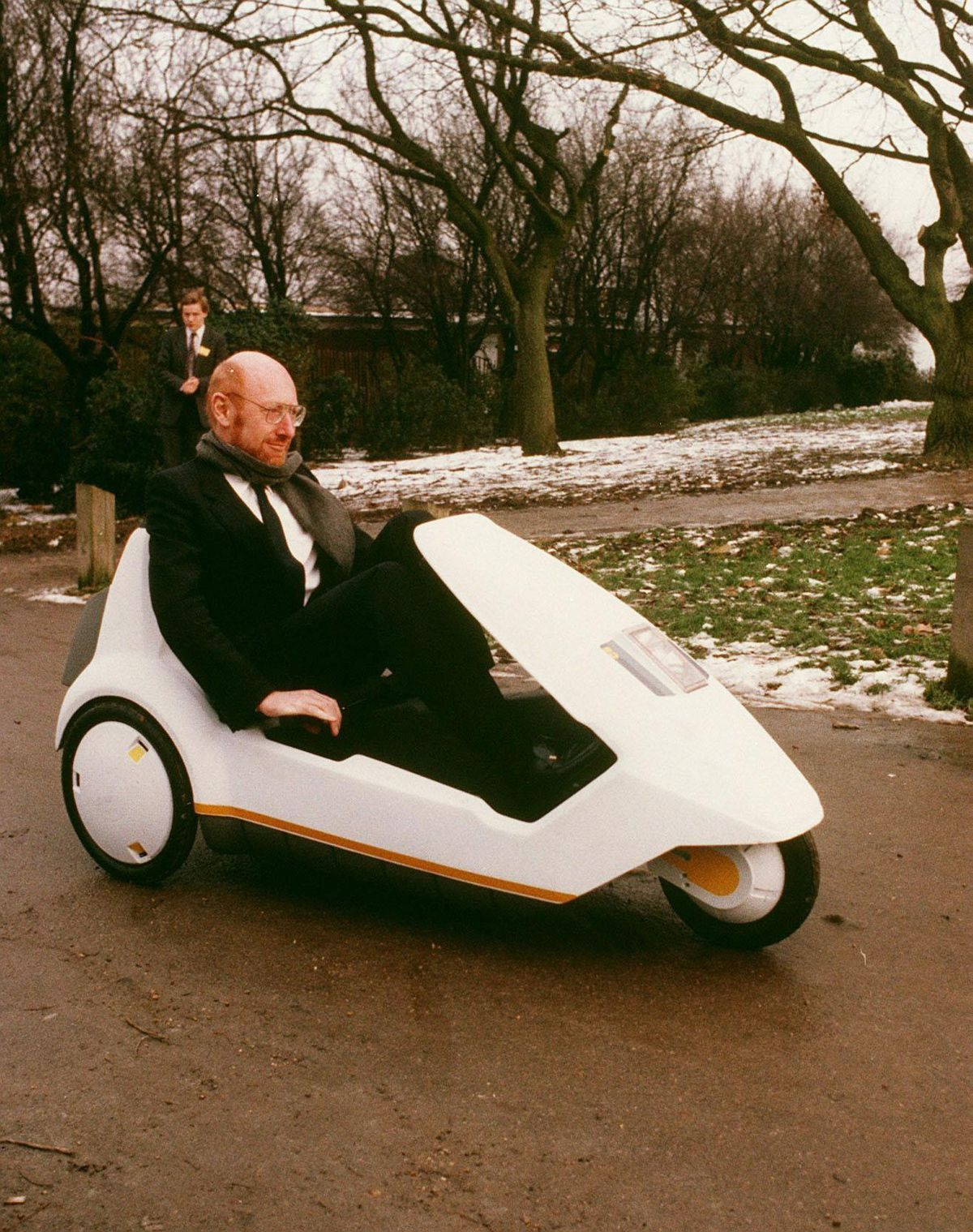 Sir Clive Sinclair demonstrating his C5 electric vehicle in 1985