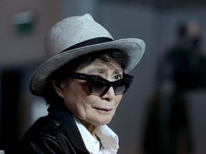 Yoko Ono wearing a hat