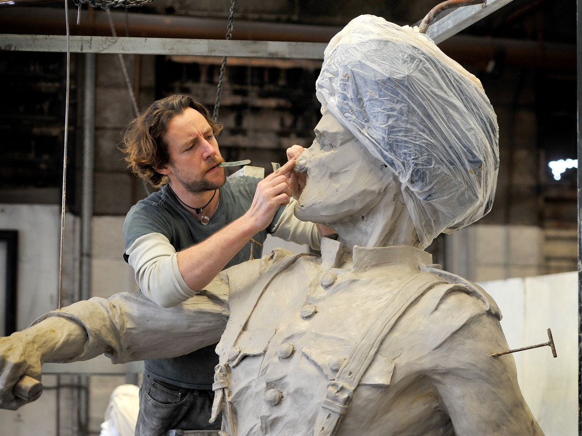 Artist Luke Perry working on the statue
