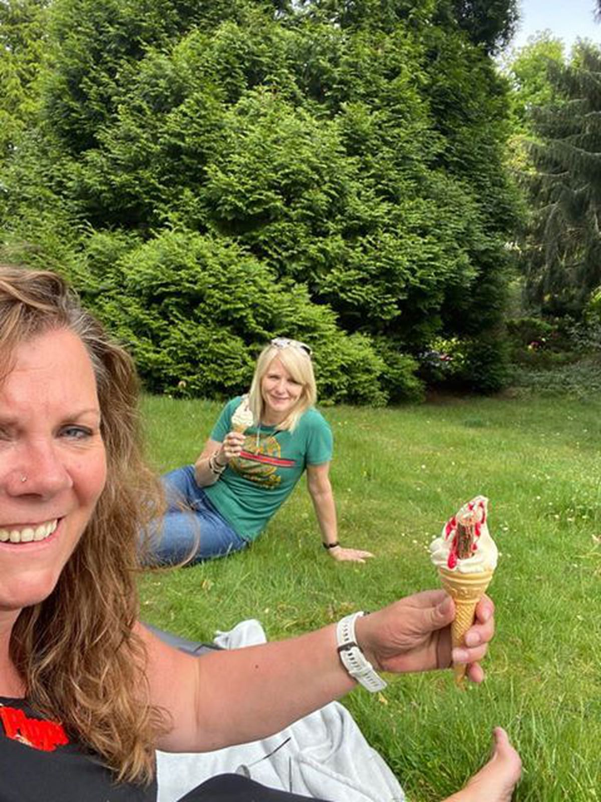 Pippa Laight and Annette Garratt share a socially distant ice cream at Haden Hill Park