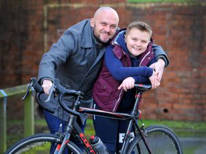 Lewis, nine, is supporting father Chris Hopkins ahead of his ride