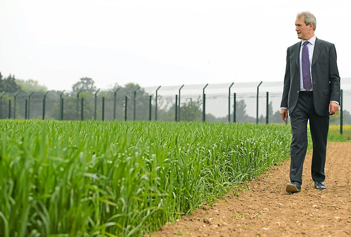 Owen Paterson viewing a genetically modified crop trial during a visit to Rothamsted Research, in Harpenden, Hertfordshire